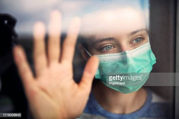 sad teenage girl staying at home during covid-19 quarantine - solitude stock pictures, royalty-free photos & images