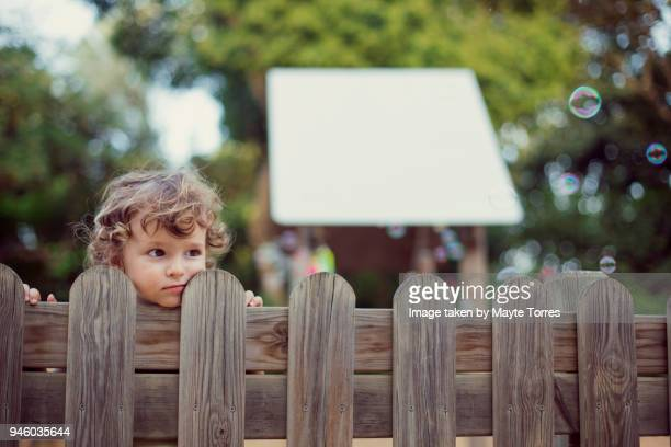 sad toddler at the playground - fence stock pictures, royalty-free photos & images
