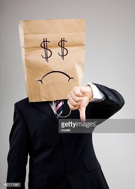 悲しい不幸せなビジネスマンギブ下向き親指