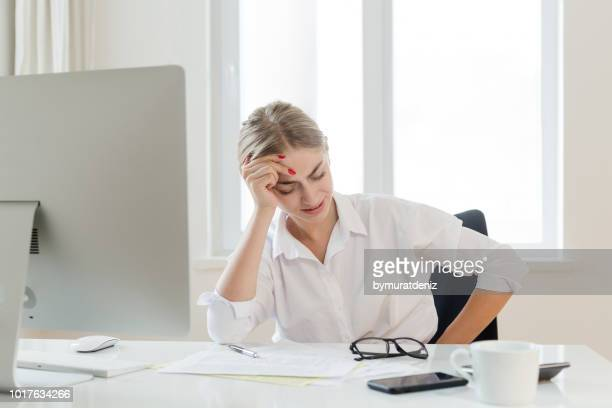 sad unhappy woman suffering from a stomachache - appendicitis stock photos and pictures