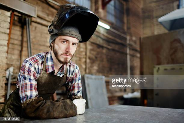 sad welder waiting for work - leaning stock pictures, royalty-free photos & images