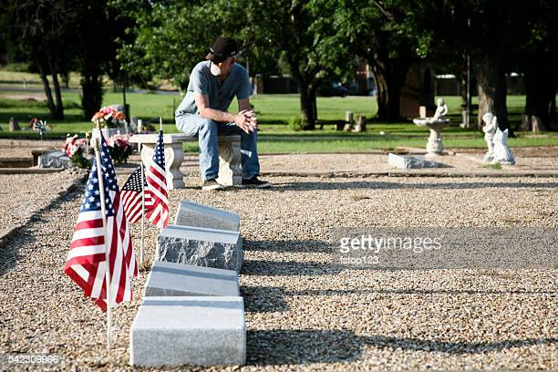 sad widower, senior adult man visits cemetery. - memorial day remembrance stock pictures, royalty-free photos & images