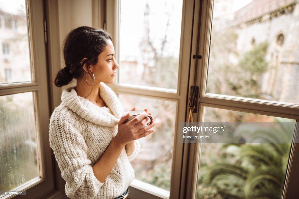 sad woman at home for the corona virus : Stock Photo