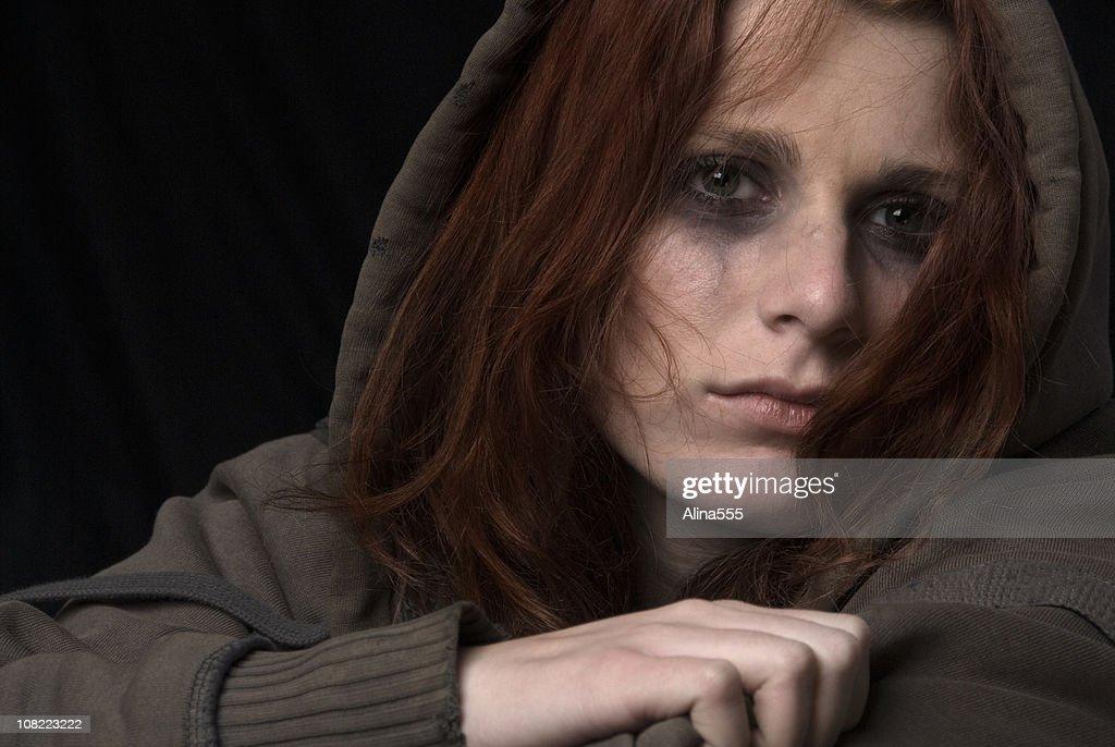 Sad woman face with smeared makeup : Stock Photo