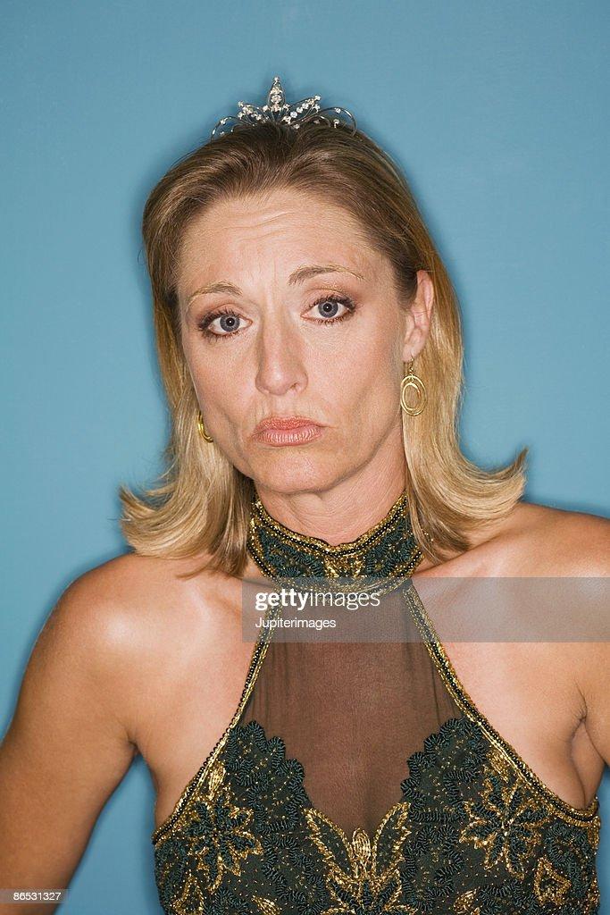Sad woman in formal attire : Stock Photo