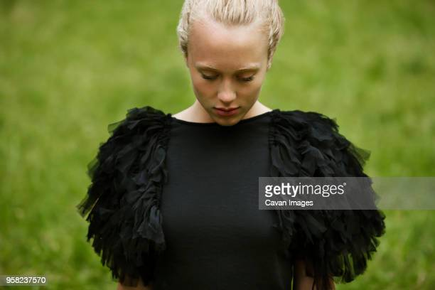 sad woman on field - waist up stock pictures, royalty-free photos & images