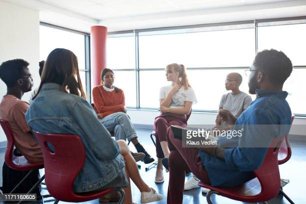 sad woman sharing with friends and instructor - community centre stock pictures, royalty-free photos & images