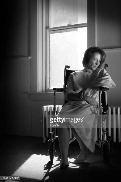 Sad Woman Sitting in Hospital Wheelchair