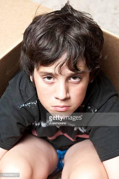 Sad young boy looking at the camera