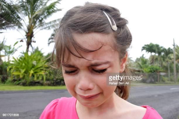 sad young girl cries when she got lost during a family holiday - rafael ben ari fotografías e imágenes de stock