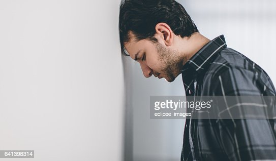 Sad Young Man In Empty Room Stock Photo Getty Images