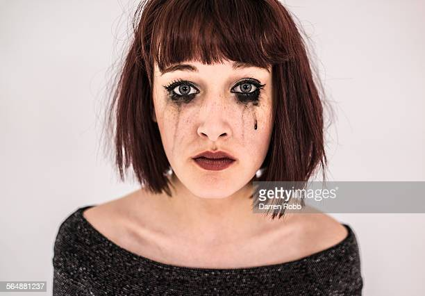 sad young woman crying with black mascara tears - tear stock pictures, royalty-free photos & images