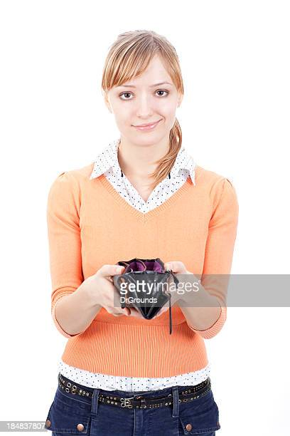 Sad young woman showing empty wallet