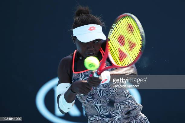 Sada Nahimana of Burundi plays a backhand in her first round Junior Girls' Singles match against Victoria Allen of Great Britain during day six of...