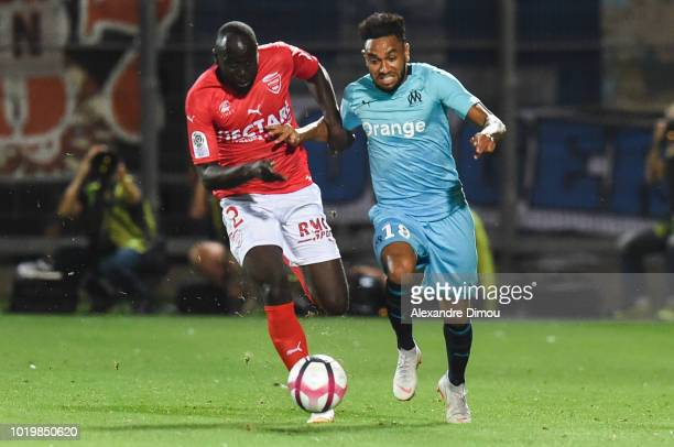 Sada Thioub of Nimes and Jordan Amavi of Marseille during the French Ligue 1 match between Nimes and Marseille at Stade des Costieres on August 19...
