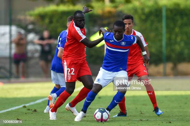 Sada Thioub of Nimes and Max Alain Gradel of Toulouse during the friendly match between Nimes and Toulouse at Stade des Costieres on July 28 2018 in...