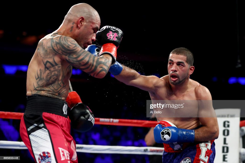 Sadaam Ali punches Miguel Cotto during their Junior Middleweight bout at Madison Square Garden on December 02, 2017 in New York City.