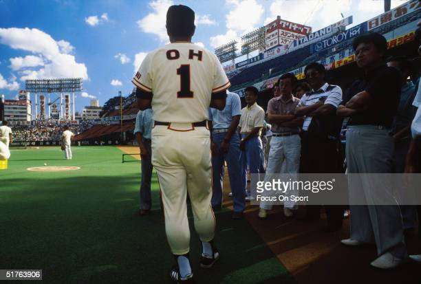 Sadaharu Oh of the Yomiuri Giants watches the game and talks to the media during a game in Tokyo Japan