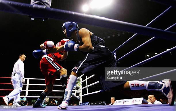 Sadam Ali of USA fights against Serik Yeleuov of Kazakhstan during the Men's Light Weight finals at the 'Good Luck Beijing' International Boxing...