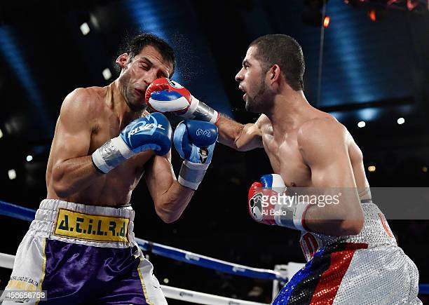 Sadam Ali punches Luis Carlos Abregu during their welterweight fight at Boardwalk Hall Arena on November 8, 2014 in Atlantic City, New Jersey.
