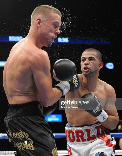 Sadam Ali throws a right to the head of Jay Krupp during their welterweight fight at Barclays Center's Cushman & Wakefield Theater on September 30,...