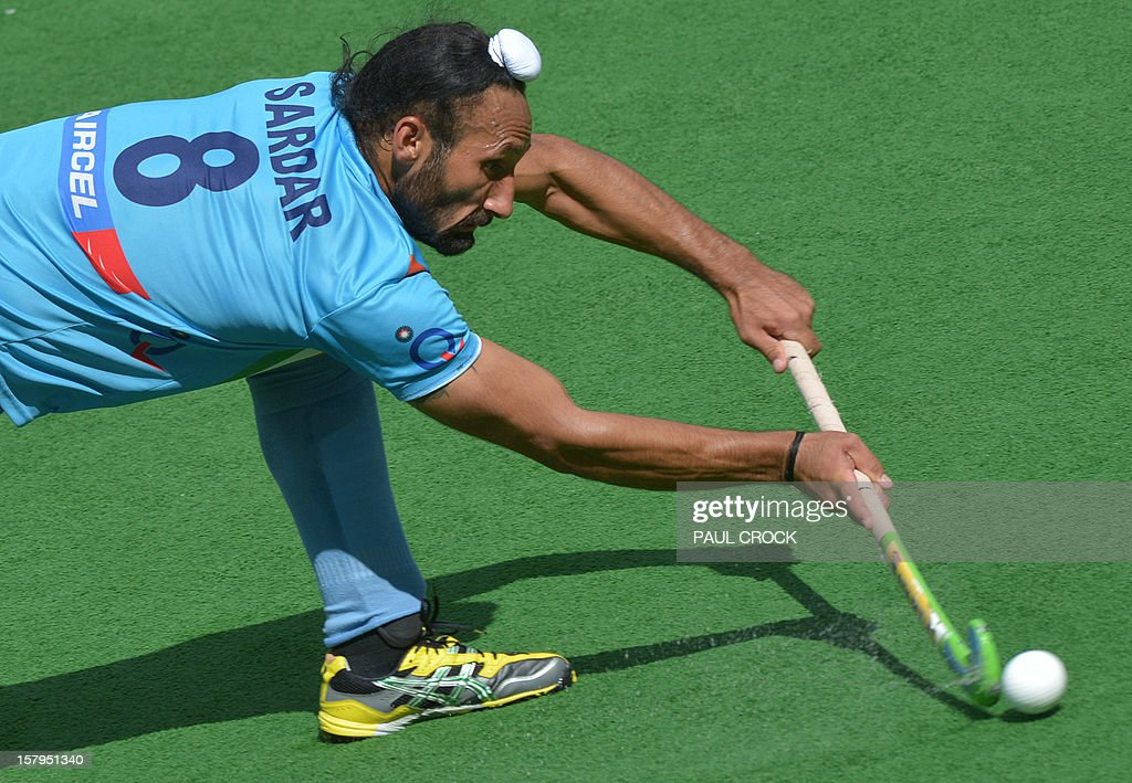 Sadar Singh of India makes a pass against Australia during the second semifinal at the men's Hockey Champions Trophy tournament in Melbourne on December 8, 2012. IMAGE STRICTLY RESTRICTED TO EDITORIAL USE - STRICTLY NO COMMERCIAL USE AFP PHOTO / Paul CROCK