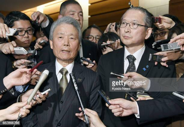 Sadayuki Sakakibara chairman of the Japan Business Federation and Rikio Kozu chief of the Japanese Trade Union Confederation meet the press after...