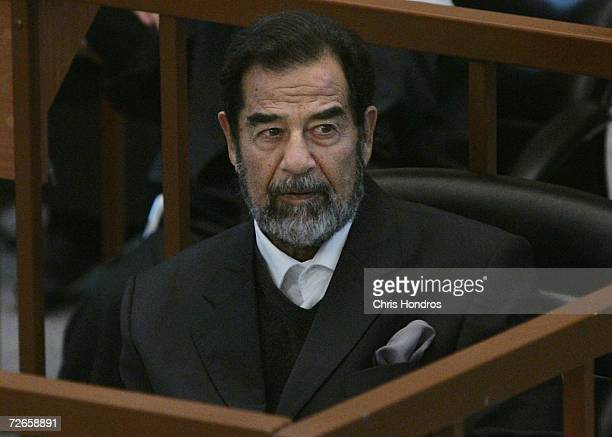 Saddam Hussein listens in court during the continuation of his 'Anfal' genocide trial November 28 2006 in Baghdad Iraq The trial resumed with charges...