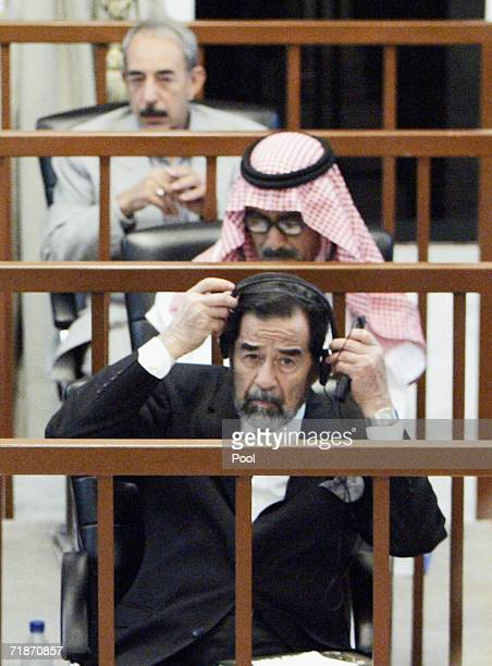 Saddam Hussein listens to a defence testimony during his trial in the fortified Green Zone on September 13 2006 in Baghdad Iraq The former Iraqi...