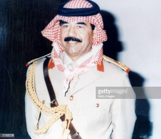 Saddam Hussein poses in an undated photo Officials say the United States is offering a $25 million reward for any information leading to the capture...