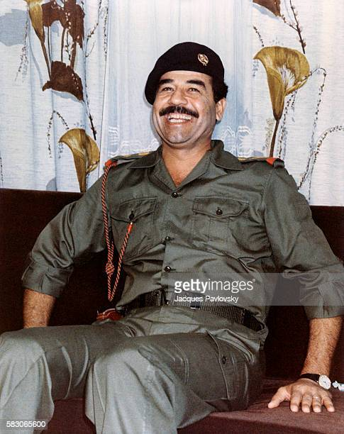 Saddam Hussein relaxes during his stay on the Saaif Saab front line