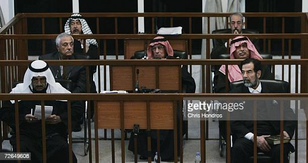 Saddam Hussein sits in court along with codefendents Ali Hassan AlMajid Taher alAni Sabir alDouri Hussein Rashid Muhammad Sultan Hashim and Farhan...