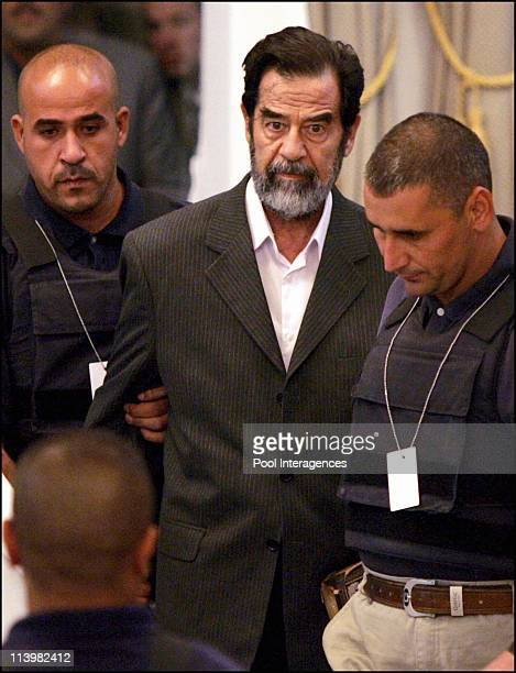 Saddam Hussein Trial In Baghdad Iraq On October 19 2005 Former Iraqi President Saddam Hussein attends his trial held under tight security in...
