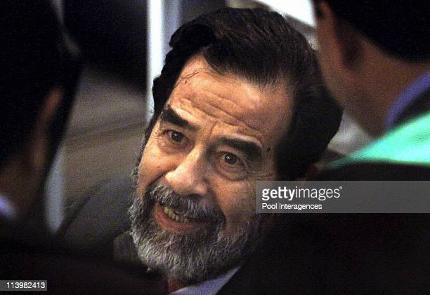 Saddam Hussein Trial In Baghdad Iraq On October 19 2005 Former Iraqi President Saddam Hussein smiloes as he talks to his lawyers at his trial held...