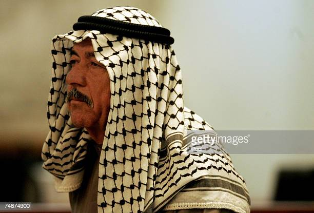 Saddam Hussein's cousin Ali Hasan AlMajid also known as Chemical Ali stands in court as he listens to his verdict beign pronounced by Chief Judge...