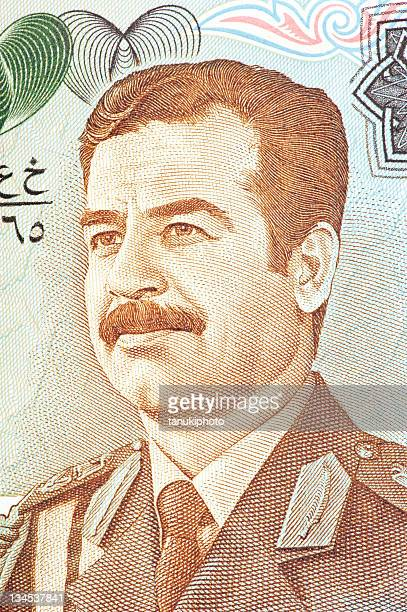 saddam ussain on banknote - saddam hussein stock pictures, royalty-free photos & images