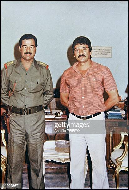 Saddam's artists in Baghdad Iraq in July 1994 Souhall Al Hindawe with Saddam Hussein
