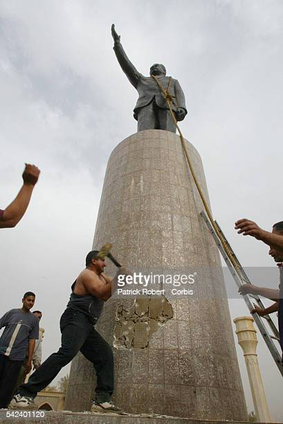 Saddam's Statue Taken Down By a US Tank A statue of Saddam Hussein is taken down as a symbolic gesture by an American tank with the help of dozens of...