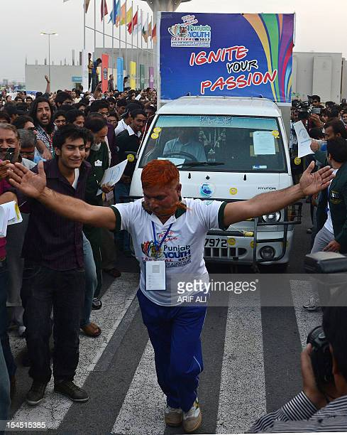 Saddi Muhammad achieves a record for using his mustache to pull a 17 tonne pickup truck a distance of 603 metres at the weeklong youth festival in...
