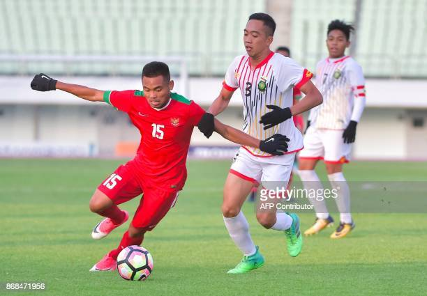 Saddil Ramdani of Indonesia fights for the ball with Abdul Wadud Ramli of Brunei Darussalam during their AFC U19 Championship qualifying football...