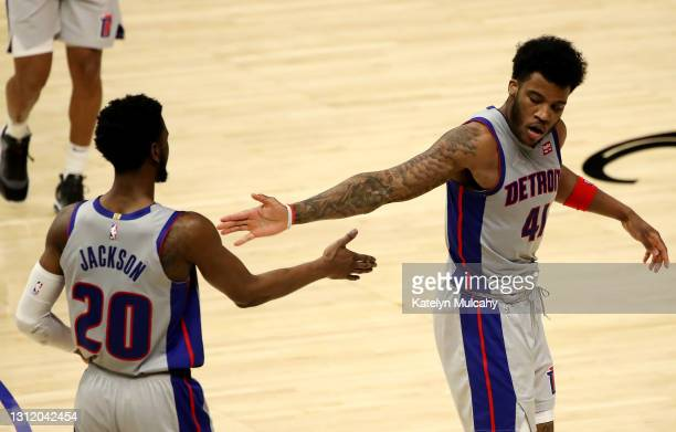 Saddiq Bey and Josh Jackson of the Detroit Pistons react to the play during the third quarter against the Los Angeles Clippers at Staples Center on...