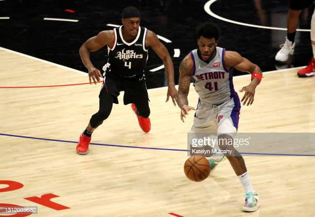 Saddiq Bey of the Detroit Pistons loses control of the ball under pressure by Rajon Rondo of the Los Angeles Clippers during the second quarter at...