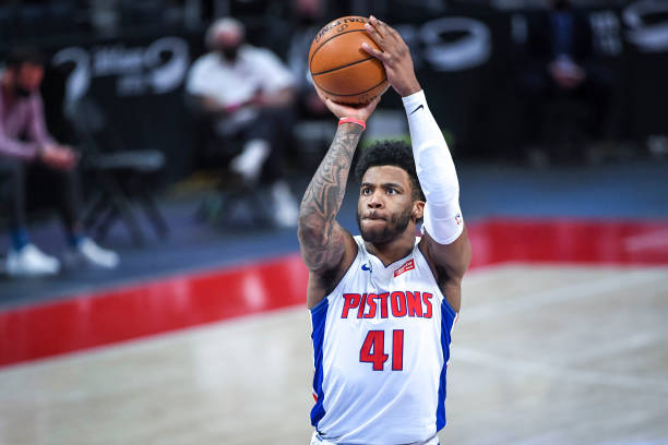 Saddiq Bey of the Detroit Pistons shoots a free throw during the fourth quarter of the NBA game against the Denver Nuggets at Little Caesars Arena on...
