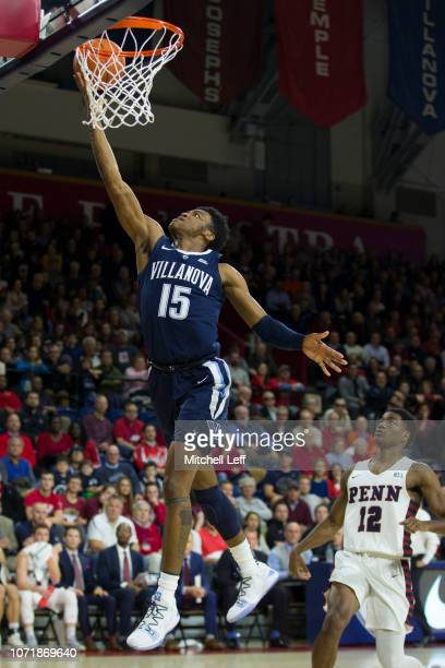 Saddiq Bey of the Villanova Wildcats attempts a lay up against Devon Goodman of the Pennsylvania Quakers in the first half at The Palestra on...