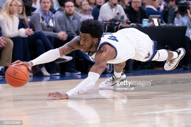 Saddiq Bey of the Villanova Wildcats dives for the ball against the Providence Friars in the first half at the Wells Fargo Center on February 29 2020...