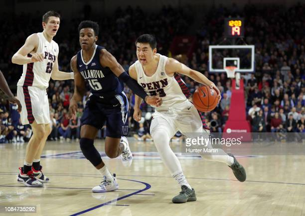 Saddiq Bey of the Villanova Wildcats guards Michael Wang of the Pennsylvania Quakers during a game at The Palestra on the campus of the University of...
