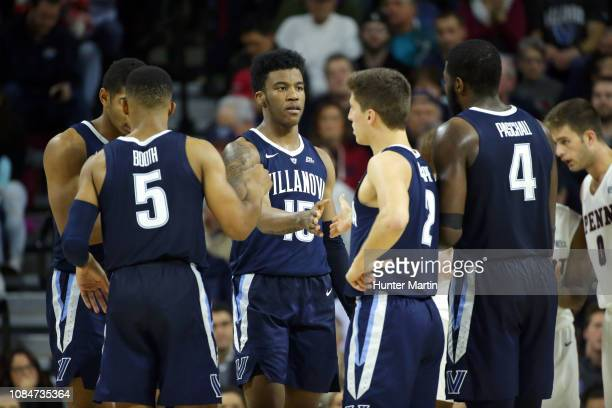 Saddiq Bey of the Villanova Wildcats huddles with teammates during a game against the Penn Quakers at The Palestra on the campus of the University of...
