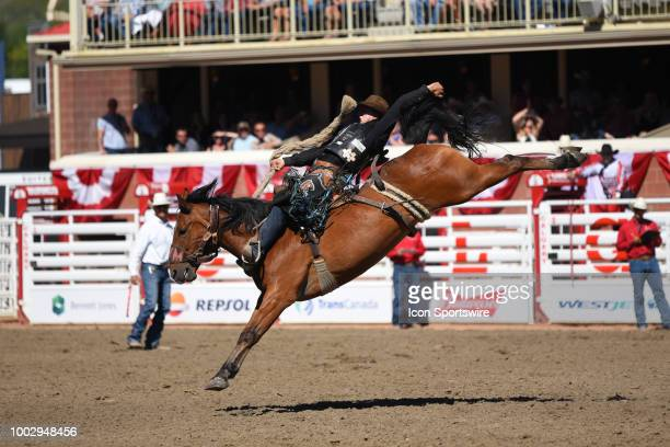 Saddle bronc rider Zeke Thurston of Big Valley AB competes in the finals at the Calgary Stampede on July 15 2018 at Stampede Park in Calgary AB