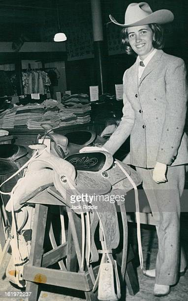 JUN 25 1966 JUL 16 1966 Saddle will go to winner of wild horse race Judy Wood of Golden shows the prize for the race sponsored by The Denver Post at...