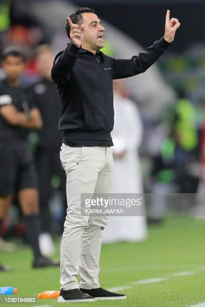 Sadd's coach Xavi Hernandez directs his players during the Amir Cup final football match between al-Sadd and al-Arabi at Al-Rayyan Stadium in...